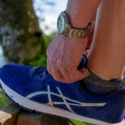 Running shoes with Medicare doctor-prescribed shoe orthotics inside