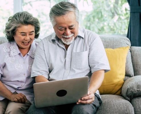 A senior couple using technology for a virtual visit included in their CMS telemedicine coverage