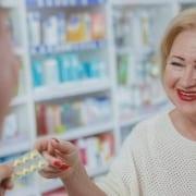 A senior on Medicare visiting a senior care pharmacy for prescription help