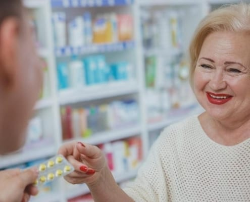 A senior on Medicare visiting a senior care pharmacy for prescription help